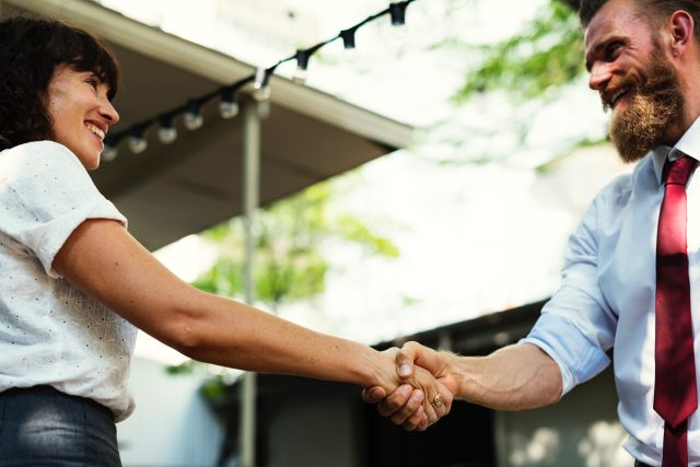 business owner shaking hands with VA